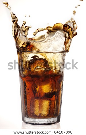 dramatic cola splash, there is some movement in the splashes - stock photo