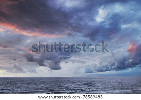Dramatic colorful sky and sea - stock photo