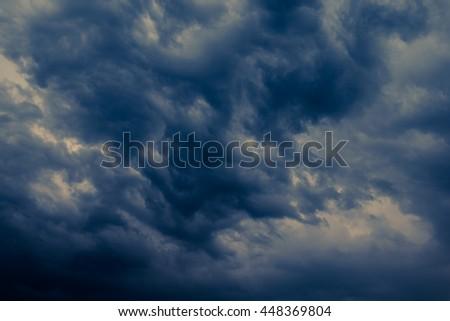 Dramatic dark clouds before thunderstorm in rainy season - stock photo