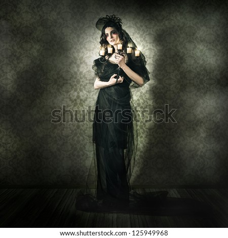Dramatic Dark Portrait Of A Beautiful Gothic Model Posing Inside Vintage Haunted House In A Depiction Of Alternative Fashion - stock photo
