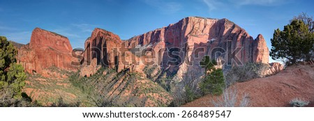 Dramatic evening panoramic sunset of a red rock sandstone canyon wall in Kolob - Zion National Park, Utah, USA