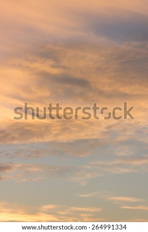 Dramatic evening sky at sunset with fiery clouds, illuminated by the sun, but without sun. Beautiful heavenly texture background, vertical shot - stock photo