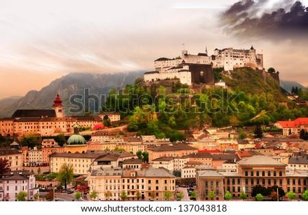 dramatic landscape before a sunset over Salzburg, Austria - stock photo