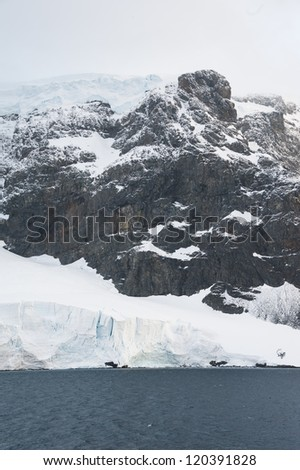 Dramatic landscape in Antarctica, huge mountain - stock photo