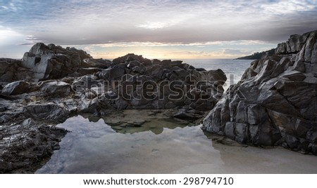 Dramatic Landscape With Clouds, Ocean and a Rocky Coastline During a Sunrise at Granite Bay, Noosa Heads, Sunshine Coast, Australia - stock photo