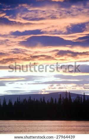 dramatic light on a evenings sky in Karelia (Russia) - stock photo
