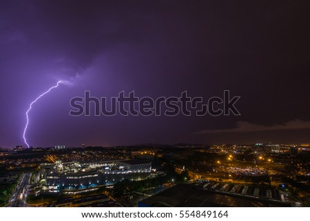 Dramatic Lightning Flash In The Dark Night Sky Strike On The Ground In A City