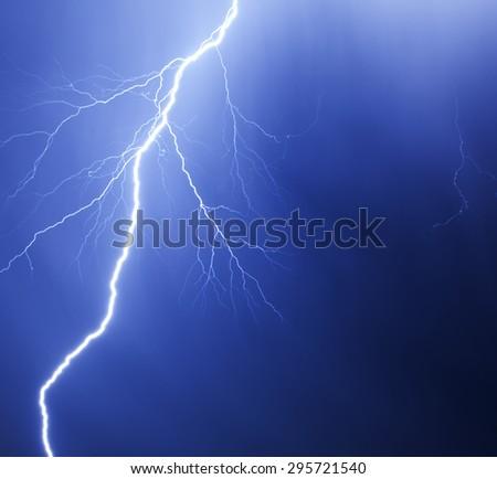 Dramatic Lightning Strike against a dark blue sky - stock photo