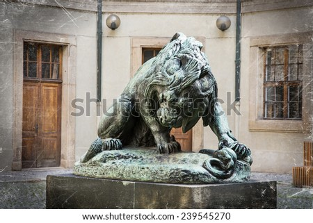 Dramatic lion statue in courtyard of the palace. Czech symbol. - stock photo
