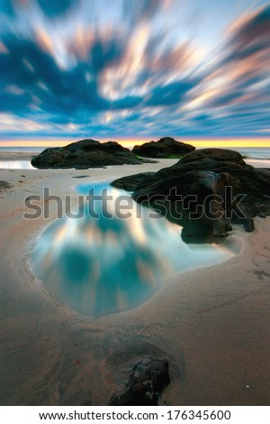 Dramatic long exposure shot of sunset at a beach in Sabah, Borneo, Malaysia - stock photo