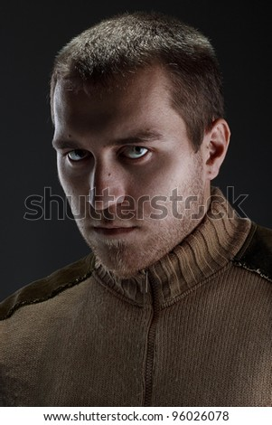 dramatic male portrait on a dark background