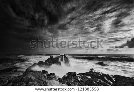 Dramatic mood beach scene in black and white - stock photo