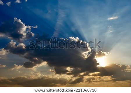 Dramatic morning sky with a bright sunrays