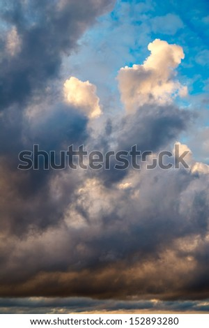 Dramatic morning sky with dark rain clouds - stock photo