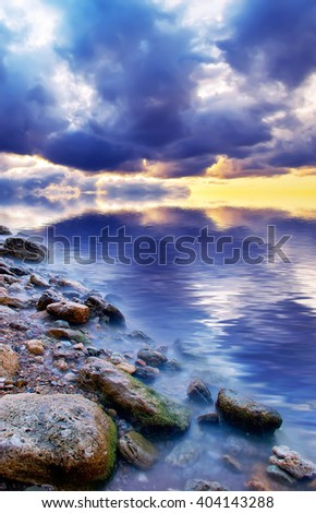 Dramatic natural sea sunset. Natural composition - stock photo