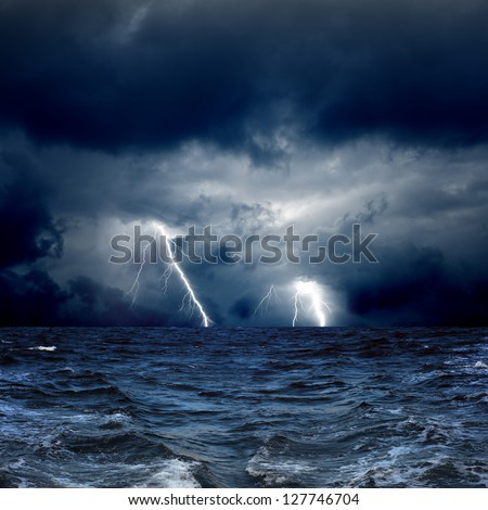 Dramatic nature background - lightnings in dark sky, stormy sea - stock photo