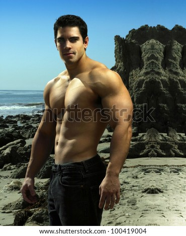 Dramatic outdoor portrait of a very muscular male fitness bodybuilder - stock photo