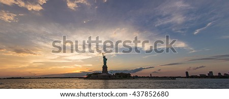 dramatic panorama of Statue of Liberty during sunset