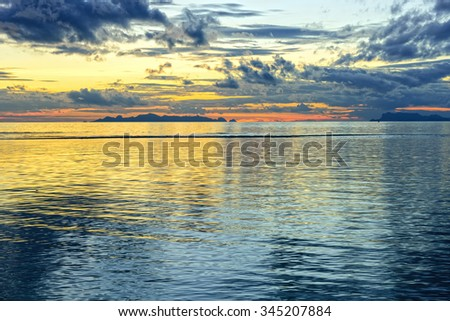 Dramatic panoramic beach sky sunset background - stock photo