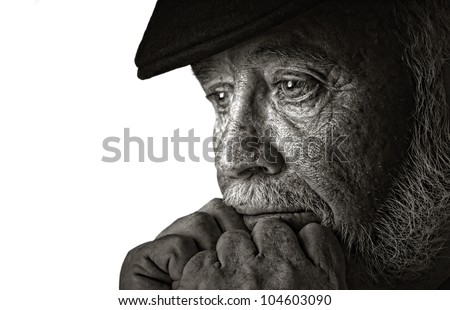 Dramatic portrait of a elderly man contemplating retirement - stock photo