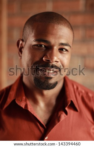 Dramatic portrait of smiling African American man. Closeup. - stock photo