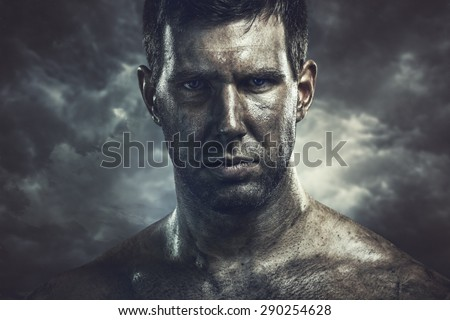 Dramatic portrait of young dirty man - stock photo