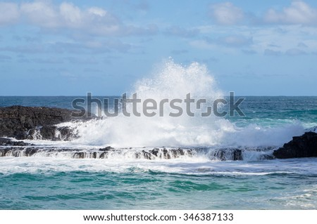 Dramatic powerful waves crash over rocks on dangerous beach at Lumaha'i, Kauai, Hawaii