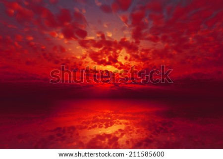 dramatic purple sunset over calm sea - stock photo