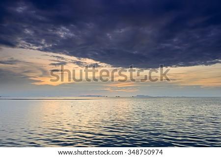 Dramatic rain cloud,sea and sky at dusk - stock photo