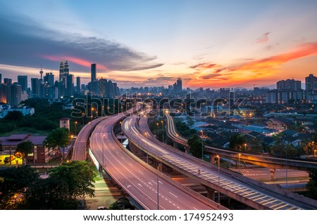 Dramatic scenery of elevated highway heading towards Kuala Lumpur city centre during sunset