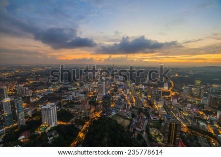 Dramatic scenery of the Kuala Lumpur city at sunset - stock photo