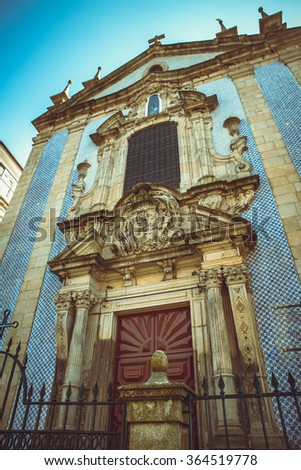 Dramatic shot of the Sao Nicolau parish church in Porto. - stock photo