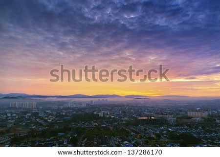 Dramatic sky and amazing view to top view at sunrise - stock photo