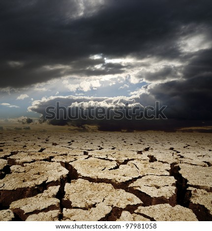 dramatic sky and drought earth - stock photo