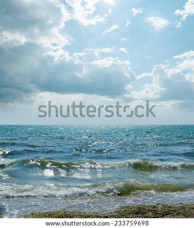 dramatic sky and waves on sea - stock photo