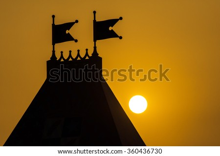 Dramatic Sky during sunset natural background and silhouette castle - stock photo
