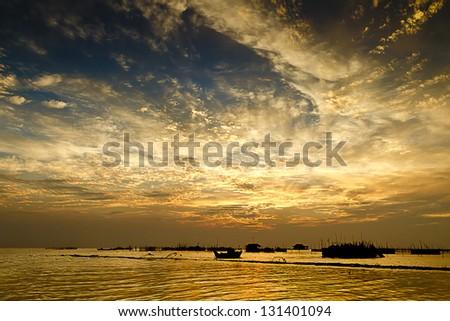 Dramatic sky over a lake - stock photo