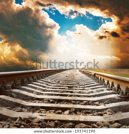 dramatic sky over railroad - stock photo