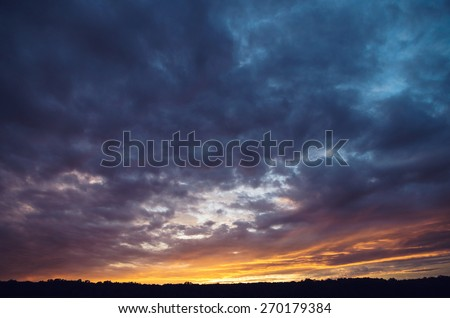 Dramatic sky over the forest - stock photo