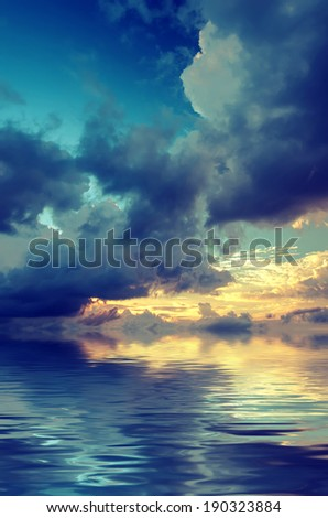 Dramatic sky over the sea during sunset. Vintage picture