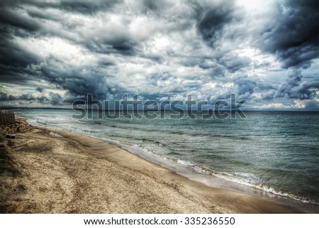 dramatic sky over the sea in the winter - stock photo