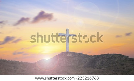 Dramatic sky scenery with a mountain cross.
