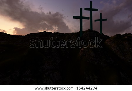 Dramatic sky silhouettes three wooden crosses with shafts of sunlight breaking through the clouds