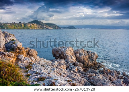 Dramatic spring sunset on the cape Milazzo, nature reserve Piscina di Venere, Sicily, Italy, Tyrrhenian sea, Europe. - stock photo
