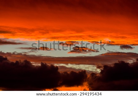 Dramatic stormy sky at sunset  - stock photo
