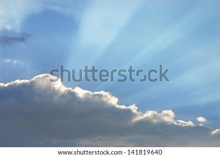 Dramatic sunbeams and storm clouds over Maine. - stock photo
