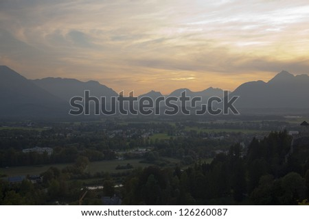 Dramatic sunlight over Salzburg valley with mountains in distance