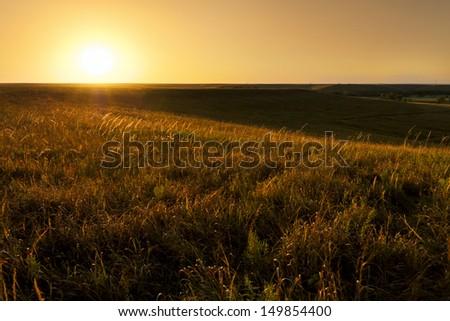 Dramatic sunrise photo at the Kansas Tallgrass Prairie Preserve Park. - stock photo