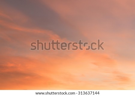 Dramatic sunrise sky with clouds.Blur or Defocus image. - stock photo