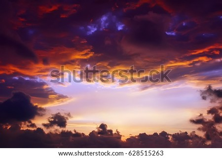 Dramatic sunrise/sunset cloudscape with copy space